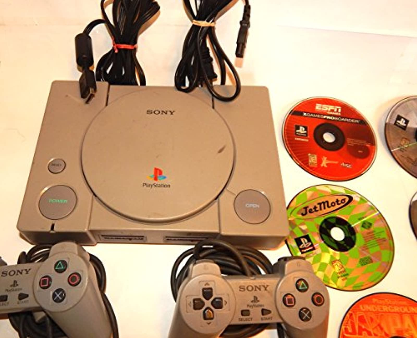 Sony PlayStation Gray Console And 8 Games And 2 Controllers And Cables Sports Sp